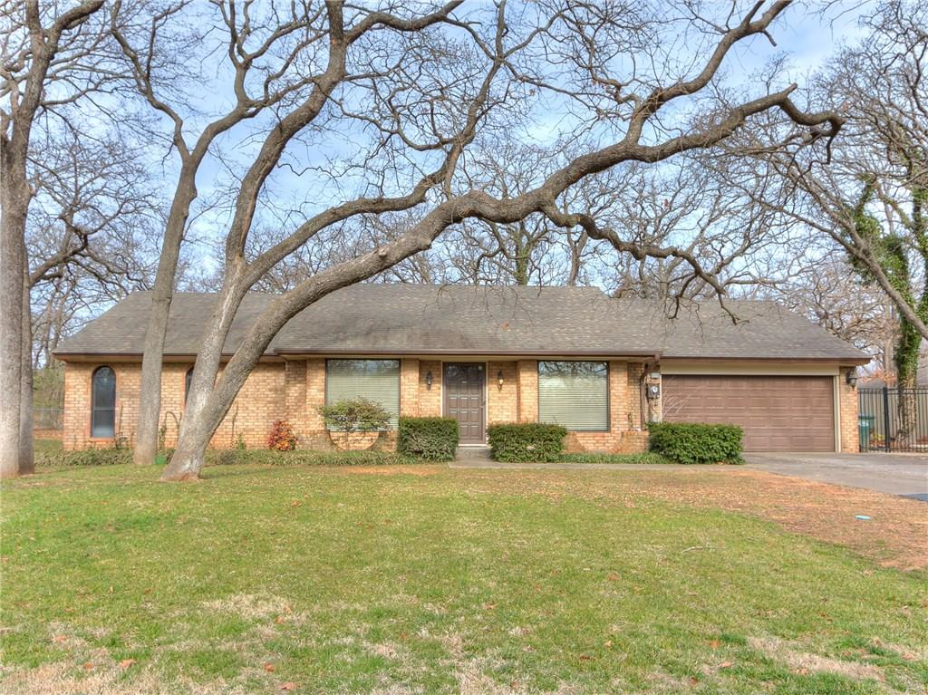 RARE RETREAT! One-owner, 4 bed, 2.5 bath charming home on 1.4 acres (mol) in Edmond with NO HOA. Kitchen has granite, double ovens, cook top, microwave, pantry cabinet with pullout drawers, undermount lights, breakfast bar & spacious eat-in area. Formal Dining room has vintage, gold, tulip chandelier & built-in corner buffet. 2nd living area can be used as sitting or reading area, where you can enjoy the views & abundant natural light from the large windows. Expansive living room has bookshelves & large fireplace. Half Bath is located off the utility room. Master has walk-in closet, full bath, & new storm door for access to Master Suite's own open patio. 2nd bath access from the hall or from 3rd bedroom. 2 car Garage has insulated doors, additional space, access to extended covered deck/patio, New Trane HVAC 2017 & Water heater 2014. Cement walk from back patio to front drive. Part of lot backs to Bryant, with potential for direct access to future workshop. Horses & Chickens allowed!
