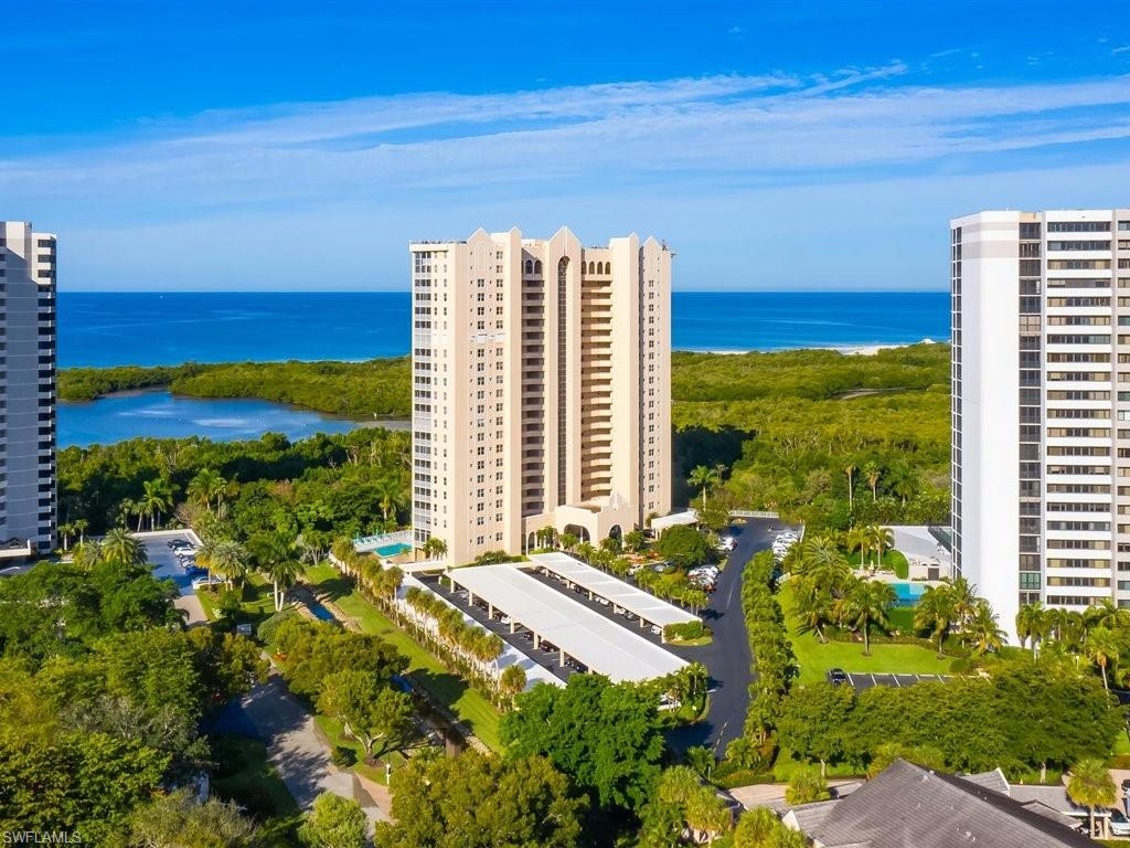 """SPECTACULAR ST. NICOLE CONDO BOASTS 10,000,000 PANORAMIC 180-DEGREE DIRECT GULF & BEACH VIEWS (NOT TO MENTION THE DOLPHINS, MANATEES & WILDLIFE!) THIS """"05"""" COVETED 19TH FLOOR 3-BEDROOM, 2 BATHS, HAS IT ALL! OVER $100,000 IN RECENT UPGRADES & RENOVATIONS.THE CHEF'S KITCHEN W/ SOLID WOOD CABINETRY, STAINLESS STEEL APPLIANCES, GRANITE TOPS, & PANTRY.  HOME IS BEING OFFERED FURNISHED. THE MASTER BEDROOM HAS HIS/HER WALK-IN CLOSETS, DUAL GRANITE SINKS & VANITY, WALK-IN TILE SHOWER & SOAKING TUB. LANAI HAS BEEN """"GLASSED IN"""" FOR ADDITIONAL LIVING & ENTERTAINMENT SPACE, AND COULD ALSO BE ADDITIONAL GUEST SLEEPING SPACE IF NEEDED. UNIT HAS PLENTY OF STORAGE & AN EXTRA STORAGE UNIT JUST OUTSIDE THE DOOR. DESIGNER LIGHT FIXTURES, CUSTOM MIRRORS, AND CONTEMPORARY CEILING FANS FOR THAT EXTRA TOUCH OF LUXURY. PELICAN BAY COMMONS PROVIDES RESORT STYLE AMENITIES, INCLUDING PRIVATE GOLF & TENNIS CLUB (2), WORLD CLASS HEALTH, FITNESS & WELLNESS CENTER & MILES OF JOGGING & BIKE TRAILS. HOME COMES W/ ONE YEAR HOME WARRANTY FOR TOTAL BUYER COMFORT."""