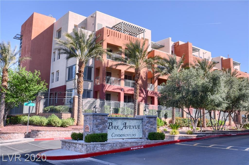 Recently upgraded condo on 4th level located within guard gated Park Avenue. New paint & vinyl flooring throughout. Window treatments, ceiling fans, balcony with mountain views. One assigned parking space within gated garage and one assigned parking space outside. Amenities include: community pool, tennis courts and two story fitness center in clubhouse with lockers, steam room and dry sauna.