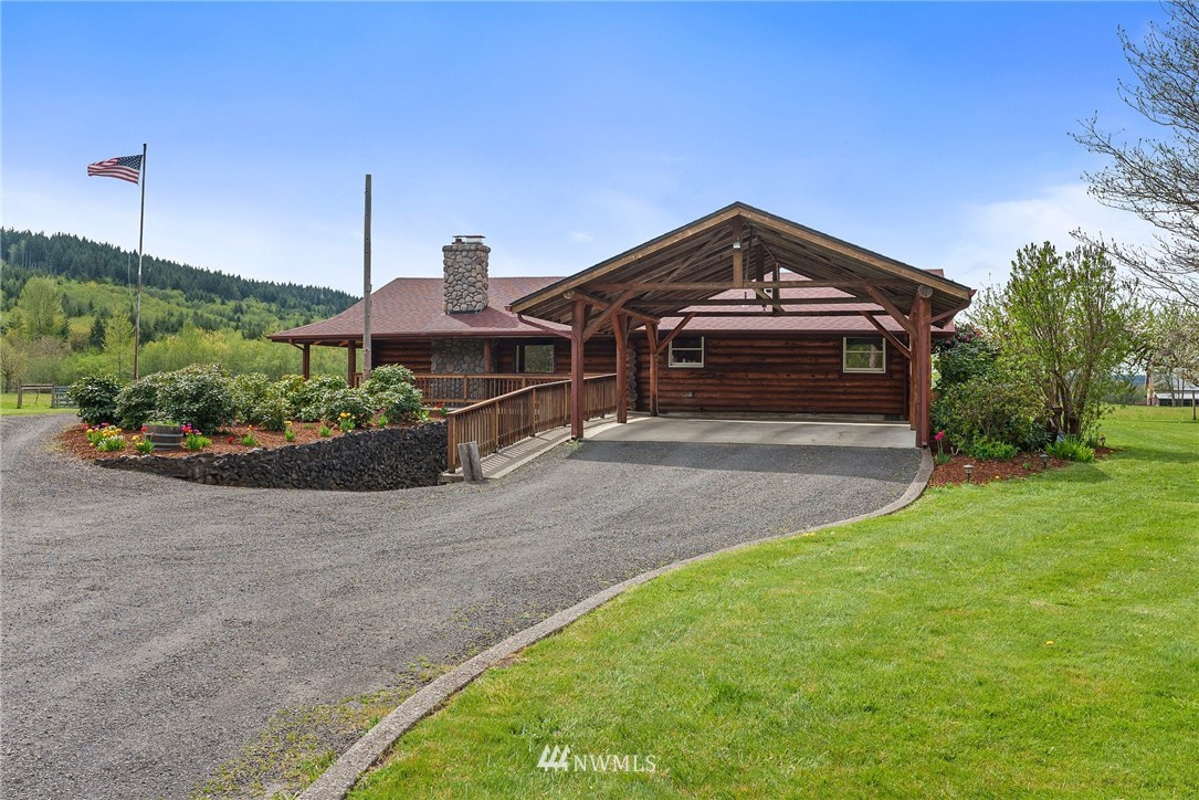This well maintained log home sits on over 8.5 acres less than 20 minutes from I-5. Two parcels offer pastures, fruit trees, a garden area, and marketable timber. The inviting open concept is complete with custom kitchen cabinets, granite countertops, stainless steel appliances and an island with additional seating. The main level also contains three bedrooms, two bathrooms (one featuring a claw foot soaking tub) and a large utility room with additional storage. Gravel drive leads to the 32x60' shop ready to fit your specific needs. Pastures are fenced and easy access to the Willapa Hills Trail is 1/2 mile down the road. Beautiful 360 territorial views, amazing sunsets and Chehalis River located just across the street.