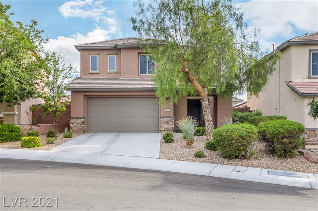 Beautiful 5 bed/3.5 bath  plus loft home located in Anthem Highlands. This gem features actual size of 3078 sq ft, all tiles throughout first floor, downstairs bed and bath. Open floor plan , iron staircase, separate family room off kitchen. Oversized master bedroom with walk in closet & private bath with separate tub and shower. Desert landscaping with covered patio. A must see....