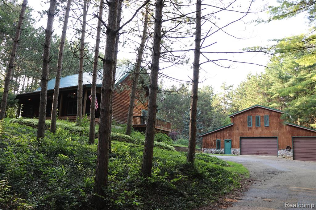 Enjoy this retreat. Outstanding Log home with tons space including 4 bedrooms, 2 baths, finished basement with a fireplace and a large rec room. In addition, this home has a large heated woodworking shop and a processing room for all your homesteading needs. Enjoy absolute privacy on this wooded 5-acre lot. The kitchen features stainless steel appliances with an island cooktop. Shining hardwood floors throughout. Newer Geo-Thermal heating/cooling system. Check out the 55 X 28 insulated and heated garage with an additional heated 25X25 rec room on the second floor. About 2 acres have been fenced in to secure your animals and an additional hay barn was recently built. Like to garden? There are 10 raised garden beds waiting for you. New Roof and retaining wall. Schedule your showing today.