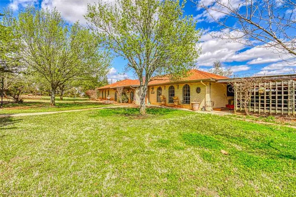 This listing has two houses. The main house is move in ready. Freshly painted inside. It has new carpet, tile and granite countertops with new sinks and faucets. The second house is a shell and is being sold as is. Each house has its own entry and is metered separate for utilities.  There is also two ponds on the property. The one pond is for the septic system. The property has two addresses.  The main house is 16808 and the little house is 16808 1/2 S Air Depot. House is 1 mile East of Belmar Golf Course. Priced under appraised value.
