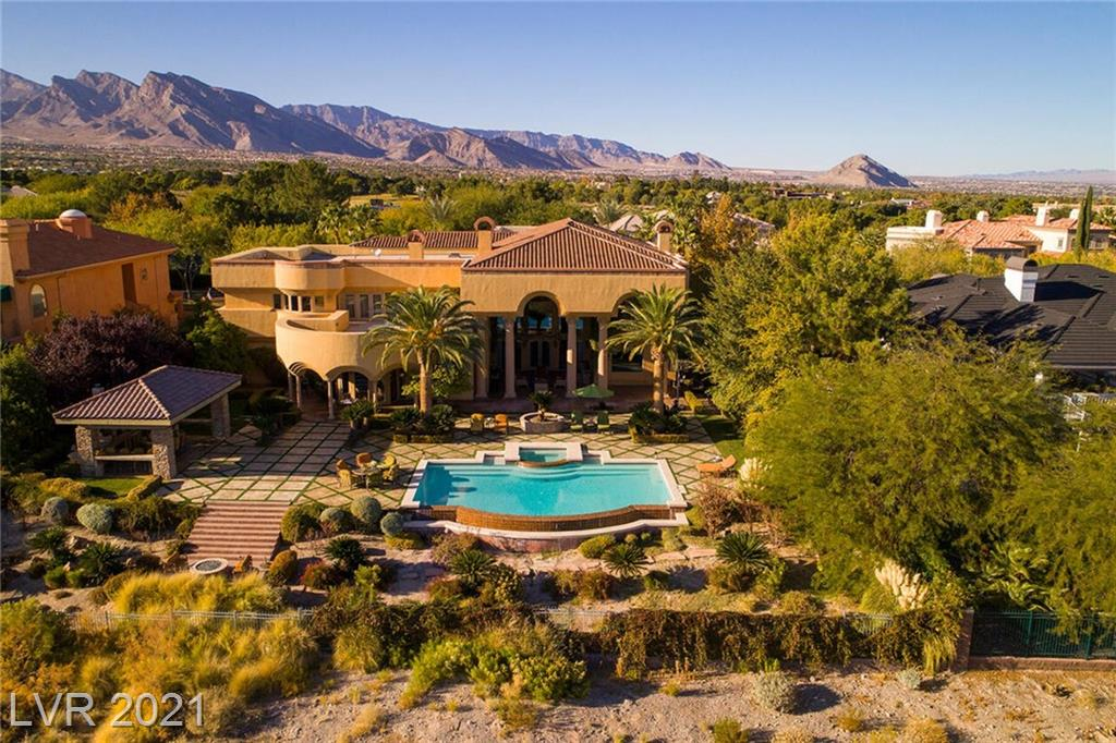 Spectacular TPC Summerlin Fairway Estate -Golf Frontage Custom in Tournament Hills with Golf, City & Mountain Views. Lee Linton AIA. 10,533 SF, 4 Bed, 7 Bath, 4 Car Garage, .82 Acres. Soaring Ceilings, Double Staircases, Wet Bar, Library/Office, Media Room, Gym, Walk-in Temperature Controlled Wine Cellar, Formal Dining Room, Chef Kitchen with Butler's Pantry and two Oversized Islands with Seating, Gourmet SubZero and Viking Appliances, Living and Family Rooms, Master Retreat w/ Viewing Deck, Fireplace, Separate Vanities, Steam Shower, Jetted Tub, His & Her Closets, Resort Pool & Spa w/ Waterfall Feature, Fire Lounge, Covered Outdoor Kitchen Room with Bar Seating and Pizza Oven. Exclusive Guard Gated Summerlin Community. Entertainer Paradise. Welcome Home