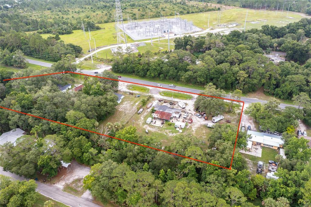 Located within 1 mile of the St. John's River Bridge, this assemblage of three parcels is zoned B-4 and offers extensive frontage on SR-44. The subject property has been an ongoing concern for over 25 years. Owner is now willing to sell, and this represents a location that is difficult if not impossible to reproduce. Each parcel has an existing structure which is usable and/or leasable. Fully fenced, the property boundaries are clearly marked and also visible from aerial footage. Please call to arrange a tour. Owner is quite helpful, and listing representative can attend to answer any questions. Survey available via this listing or upon request.  SALE INCLUDES 2819-2835 SR-44. FURTHER ASSEMBLAGE TO THE WEST IS PROBABLE. POTENTIAL ASSEMBLAGE COULD EXTEND FROM PARADISE LANE TO WITHIN A STONE'S THROW TO THE RIVER.