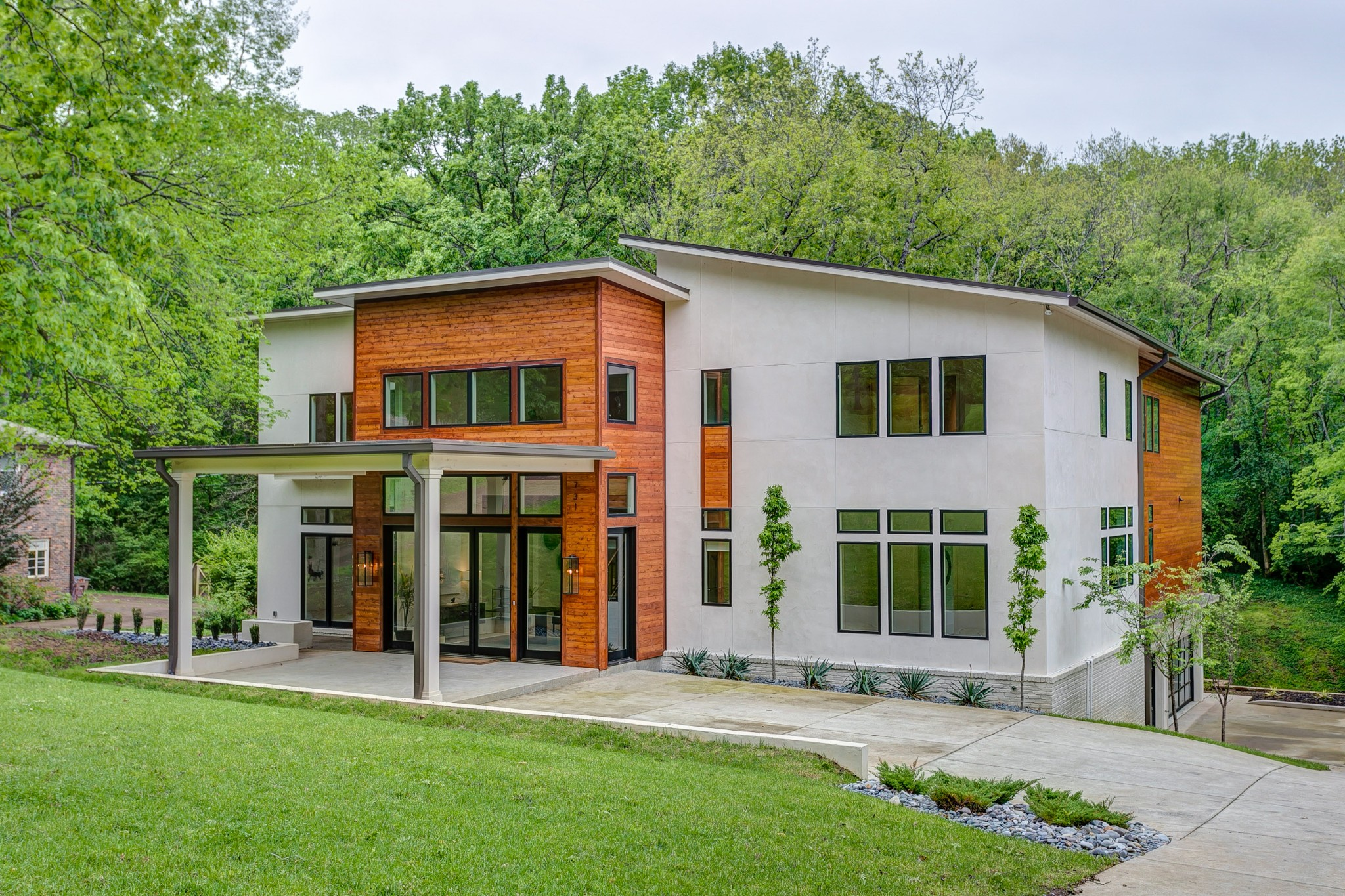 Contemporary Living ~Finest Timeless Finishes~ venetian plaster, standing seam bronze roof & gutters, floating interior steps w/ custom Railings By Art House, Zebra Wood & Macassar Ebony Kitchen Cabinets, Dacor Premium Kitchen Appliances for the gourmet cook. 6ft+ Built in pantry, Coffee Bar/Smoothie Station and more. Master Suite & luxurious Bath, Calacatta Marble and Brizo Faucets, Floating Tub and Steam Shower, custom closets. Smart Wired Crestron System It's a must see for the connoisseur.