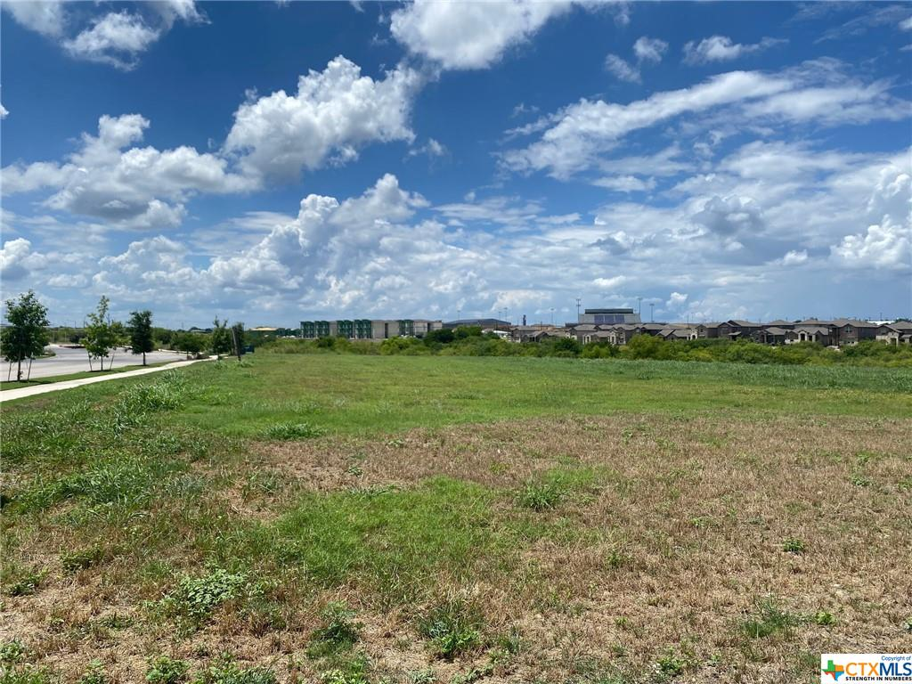 1.81 acre Corner Lot located within the Cottonwood Creek Subdivision, a master planned community filled with over 1,300 single family residences at full build out, and an estimated 800 fully built homes, currently.  There is a 350+ unit apartment site under construction within the subdivision, too.   This is a platted lot ready for building: Offsite Detention in Place, Utilities Onsite, Zoned GC—General Commercial. Potential uses: strip center, day care, office use, & more Restricted against Gas Stations and Grocery