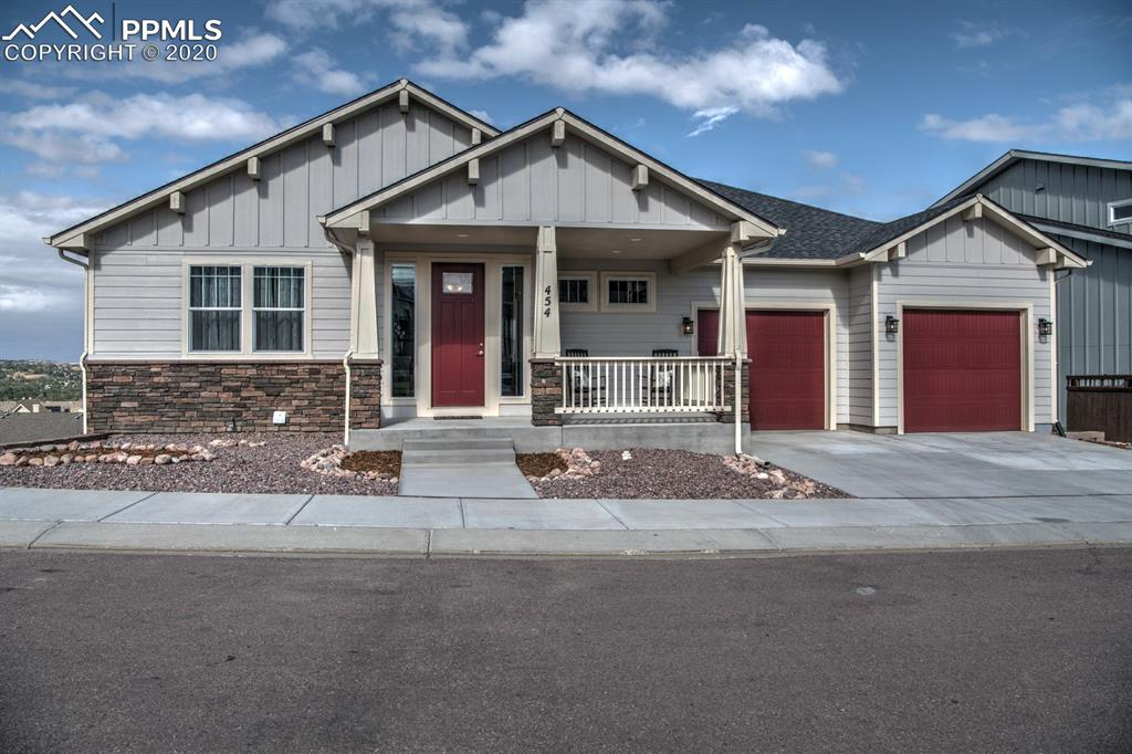 Panoramic Front Range & City Views! Enjoy One-Level Living in the Heart of Colorado Springs. New Custom Home Offers Ideal Combination of Indoor & Outdoor Living. Inviting Front Porch, Upper & Lower Rear Patios. Kitchen Features Lots of Cabinets, Prep Space, Generous Granite Island, Bosch Appliances w/Gas Cooktop & Walk-In Pantry! Open Great Rm Design. MBR Includes Dual Closets, Freestanding Tub, Spa Shower. Second Bedroom, 3/4 Bath, Tech Room & Main Level Laundry Complete Main Floor. Finished Bsmt Boasts Large Family Rm w/Wet Bar & Walk-Out, 2 Additional Bedrooms w/Walk-In Closets (1 is Junior Suite) & Tons of Storage. Walking Paths, Green Streets & Parks Provide for Active Use of Outdoor Space. Enjoy Front Yard & Common Area Maintenance, Trash Pick Up, Fitness Center & Community Center. Located Minutes to Downtown & Some of Area's Best Recreational Areas, Including Bear Creek Park & Garden of the Gods. This is Westside Living at its Finest!