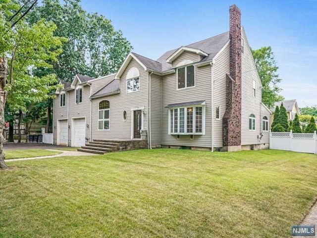 6 bed, 3.5 bath center hall colonial has apprx 4,242 sq ft, 2 decks, and a beautiful in-ground pool on a 100x125 lot. First floor has a large great room with high ceilings, living room w/ fp, dining room and large kitchen with granite counters, center island and plenty of room for a table, pantry and 2 additional hall closets. Large deck of kitchen leads to a beautiful in-ground pool. Down two stairs off main floor is a bedroom with access to the deck. 2nd floor has two wings plus a sitting area with a Juliet balcony. One wing has 2 large bedrooms, hall bath and hall closet. The other wing has a master bedroom with 2 closets and bath with stall shower and jetted tub, plus 2 additional beds and hall bath. Finished attic makes a great office or rec room. Hardwood floors on 1st floor and 2nd floor hallways. Wall-to-wall carpet in bedrooms. Oversized 2 car garage with loft. Backyard is a dream - 20x40 pool with 3-yr young liner, water-feature and koi pond w/ waterfall, play area.