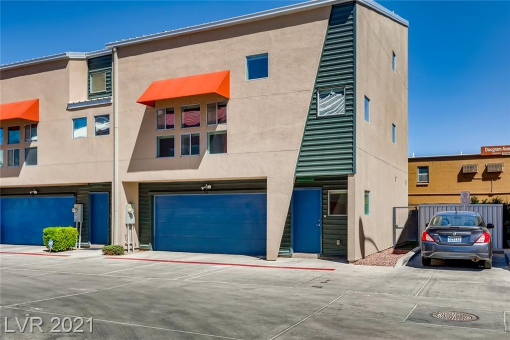 Modern Loft Style Townhome in the Fremont East area within a gated community. The three-story home is a desirable corner unit with a finished rear yard with direct access to the street. The first floor features concrete flooring with a separate large bedroom or office with yard access: separate full bathroom downstairs and Laundry room. The second floor provides a large open living and dining area, with a private windowed room with a balcony view. The Galley kitchen has granite countertops and an upgraded sink. The third floor has a bonus loft area w/separation from the primary bedroom. The primary bedroom has a large closet and spacious en suite bathroom with double sinks and a shower built for two with two separate shower heads. The 2 car garage has soft water loop and tankless water heater. Come by and experience downtown living.