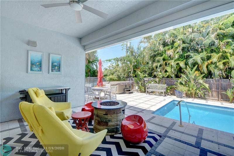 Just try finding a nicer home in Wilton Manors! Centrally located in the Sunset Manors neighborhood. Elevated newer (Built in 2014) construction on a 10,000 sq.ft. lot. Nearly 3000 sq. ft of Modern/Contemporary living space includes 3 bedrooms + Den, 2 bathrooms and a huge 2 car garage. Warm and bright living spaces thanks to huge impact windows and doors. Open custom kitchen w/white quartz counters and large bar for entertaining. Volume ceilings with crown molding. Italian Porcelain floors. Split bedroom plan with GRAND Master Suite including tray ceiling. Resort style salt water pool with separate hot tub and huge deck. Covered lounging patio. Successful Vacation Rental w/high projected income.