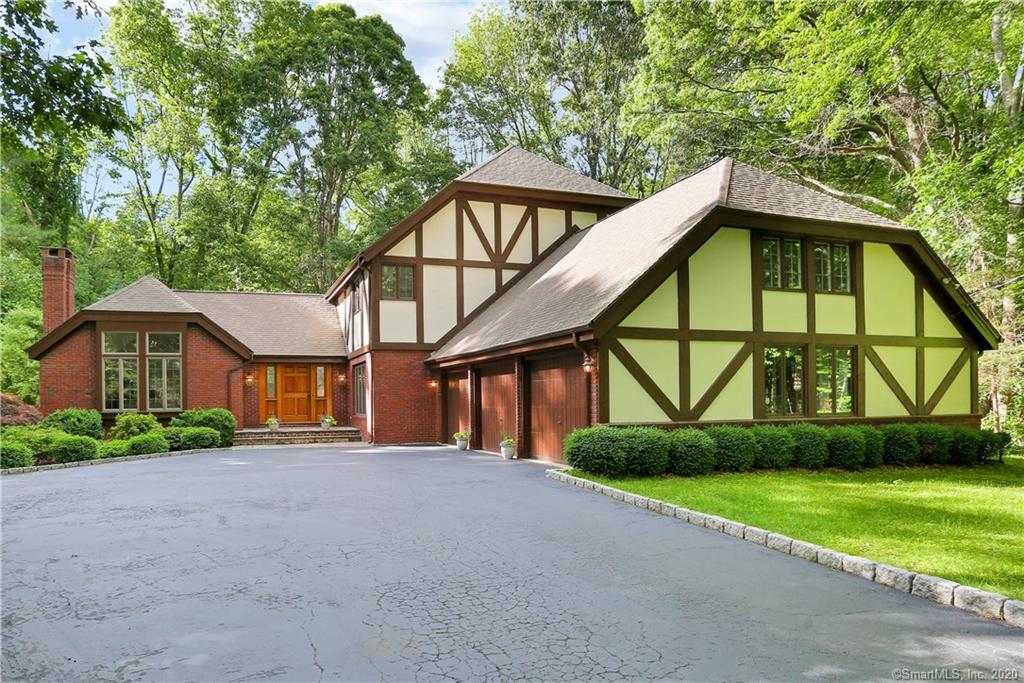 Don't miss this exceptional home! Perfect blend of sophistication and pure serenity awaits.  Tucked on a desirable cul-de-sac of 2 towns; Easton and Fairfield/Greenfield Hill neighborhood.  All gleaming hardwood floors throughout main living & easy access to yard/patio and sunroom creating incredible indoor/outdoor living & entertaining. Walk-in the front door to sun drenched 2 story foyer that flows to the incredible formal living rm with vaulted ceilings, fireplace, custom built-ins and lots of windows which provide an amazing view of the wooded yard.  Classic formal powder room in hall perfect for guests.  Formal dining room with wide opening to gorgeous kitchen with Sub-Zero & Viking appliances, granite counters, cherry cabinets & large island open to welcoming family room with gorgeous fieldstone fireplace +French doors to covered porch overlooking private property. The master bedroom is quite a retreat with fireplace, Redwood sauna, master bath w/double sinks + spa tub and 2 walk-in closets. Three bedrooms with plenty of storage space perfect for today's living.  4th bedroom suite is private & spacious.  Lower level has plenty of storage and tons of finishing potential. Award-winning Easton Schools  Enjoy 2 towns from this location-1. Fairfield provides 2 train stations, beaches, parks, marinas, & golf 2. Easton local farms for fresh dairy/vegetables/fruit, delightful eateries & coffee shop.  6.4 miles to Fairfield Metro-North, 2.7 mi. to Merritt Pkwy.