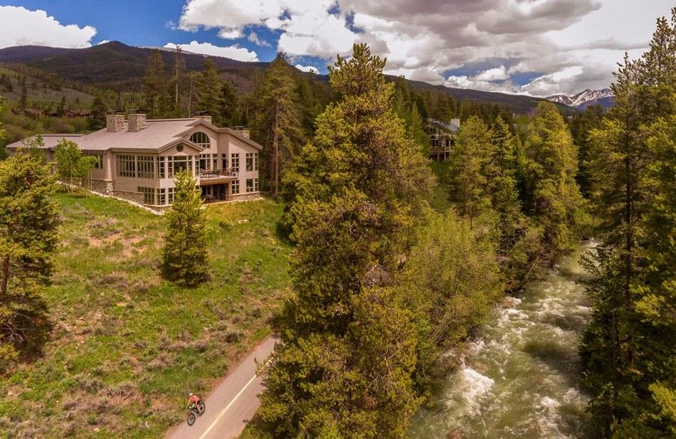 """If you are looking for a Mountain Home which brings Nature's Outside -- Inside- YOU FOUND IT. NOT YOUR TYPICAL MTN-RUSTIC Home. Designed to maximize Views and River Sounds with walls of Glass & Windows opening to capture the Snake River's roar. """"3 yr new"""" CUSTOM HOME Perched above the Snake River ON The River Golf Course just minutes from skiing. High-End Elegance with an eye for detail. MAIN FLOOR MASTER, Chef's Kitchen, Vaulted Ceilings, 3 Architectural Fireplaces, and Curved Staircases."""