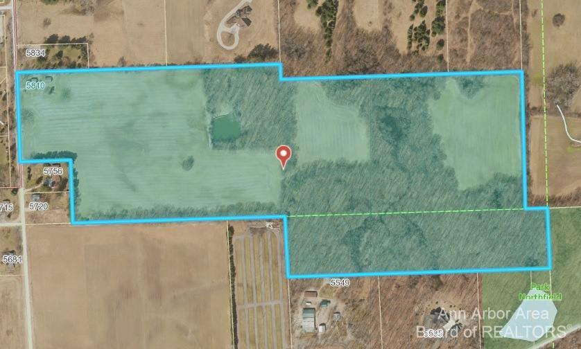 Rare opportunity for 54.41 splittable acres on the north side of Ann Arbor! Includes 10 acres zoned RC-Recreation Conservation with the balance zoned AR-Agriculture through Northfield Township. Conveniently located between N. Territorial Road and Pontiac Trail with ~470 feet of frontage along Earhart Road and easy access to US-23. This Michigan Centennial Farm has an updated 3-bed/2-bath farmhouse with recent great room and kitchen addition and newer roof. The property is also home to a detached 2.5-car garage, spring-fed pond with fish, woods for hunting or hiking, and tillable farmland suitable for corn, soybeans, and wheat. Move in and farm it yourself, rent the land to nearby farmers, or split and develop the land into highly desirable 5+ acre parcels with picturesque views. Minutes from downtown Ann Arbor, University of Michigan, and hospital campuses. Owners will also consider offers for portions of the property and split accordingly. Any offers submitted will be reviewed on Augu