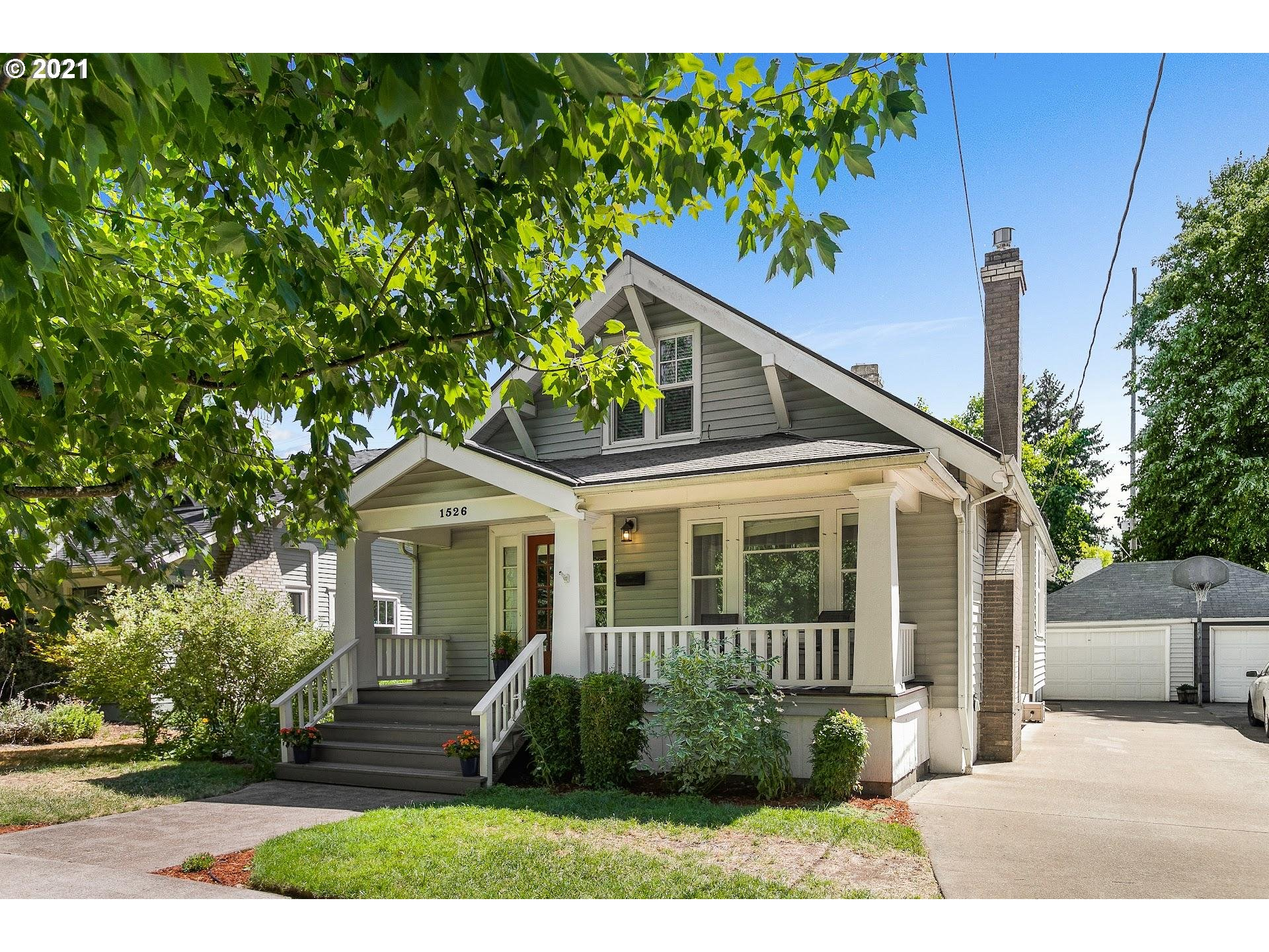 Craftsman bungalow nestled on tree lined street of Rose City.  Idyllic front porch greets you before walking into the light-filled living room. Formal dining + charming updated eat-in kitchen w/vintage flair. Expansive family room, bar area, office space down, plus 4th bedrooms, full bath, HUGE laundry room. 550 sf owners bedroom w/sitting area and mini split AC/heat. Smart mudroom off deck, perfect for Portland's wet seasons. Lush backyard w/deck, patio w/gas fire pit, a gem of a backyard.