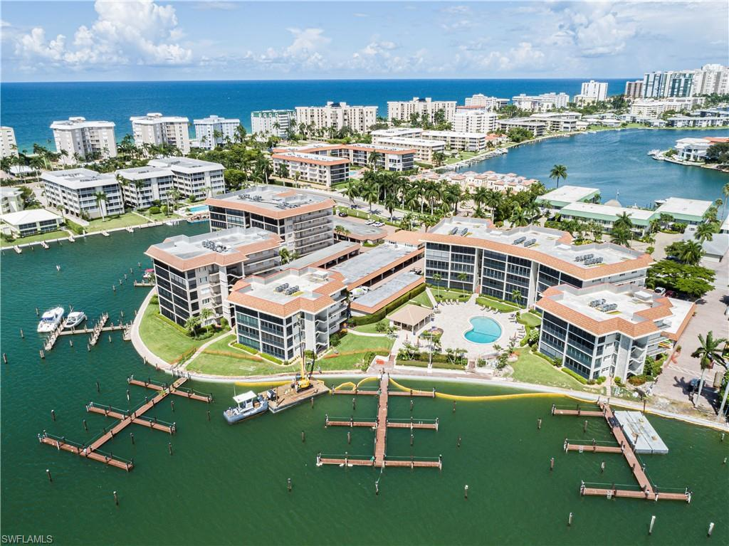 Enjoy one of Naples' famous bay views from the comfort of your own lanai.  This condo has a fantastic long water view of the bay, and includes a boat slip with direct access to the gulf with no bridges.  This location is hard to beat, with it's proximity to the beach, restaurants, shops and downtown. The kitchen and bathrooms have been recently remodeled. Optional membership is available for Moorings Country Club and Moorings Beach Park, which has private parking, restrooms, party pavilion and more.