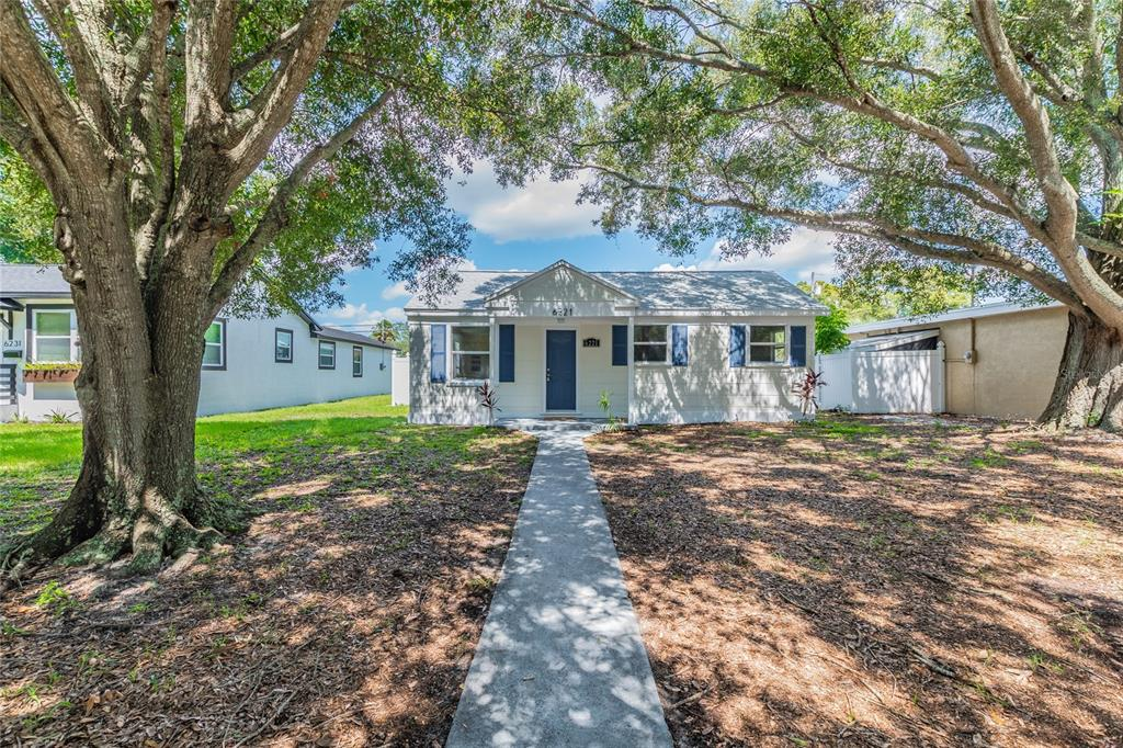 Welcome home to this beautiful and spacious 2 bedrooms 2 bath St. Pete home! If you are looking for the perfect starter or family home, look no further. GREAT fenced in backyard with enough room for a small pool or additional storage. The backyard also has a walk way from the house to the detached garage with a covered patio. This home has been renovated by the owner and includes upgrades perfectly fit for a first time home buyer or growing family. The upgraded kitchen features solid wood cabinets, stone countertops, and stainless steel appliances.  Other upgrades include NEW ROOF (2021), NEW GARAGE DOOR & MOTOR (2021), new paint, and MORE!! All of these amenities and upgrades are complimented by the unique curb appeal of the home. This home has many desirable features and is a must see. Please call us or use ShowingTime to set up a showing today!