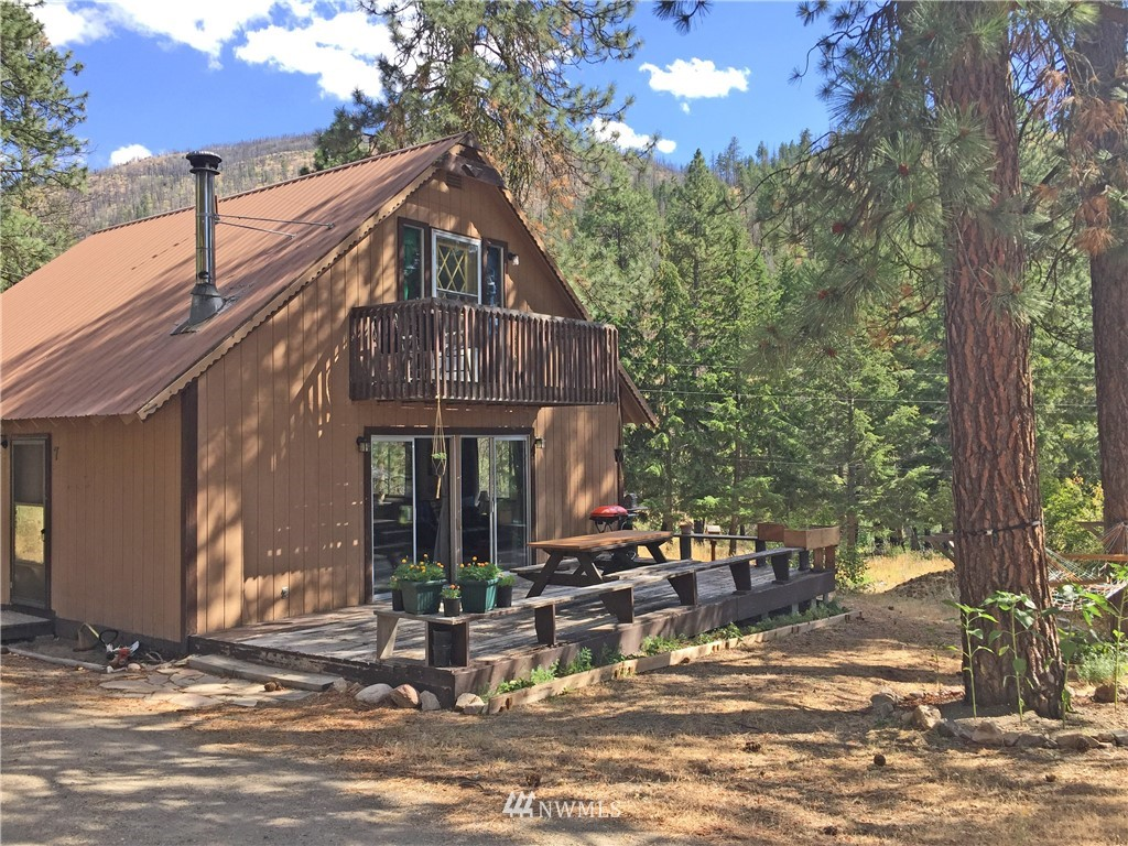 Twisp/Sims Canyon:  Super tidy 3 bedroom, 1 1/2 bath home tucked in the trees of Sims Canyon.  Access the wood porch from the slider and enjoy BBQ's and sunsets looking down the highway 20 corridor.  One main level bedroom, 2 upstairs bedrooms with 1/2 bath and private balcony.  Single space detached garage.  A solid home in the Methow Valley.