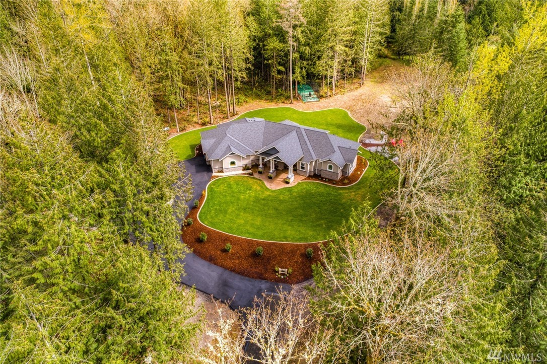 Builder's own custom luxury estate nestled on 6.4 peaceful acres. From the energy efficient construction & smart home features to the custom chefs kitchen w/expansive island, no detail was overlooked in this magnificent rambler.  Down a quiet road & perfectly placed atop the hill providing your own peaceful private retreat.  All this, yet less than 30 miles to Seattle, only 13 miles to Microsoft & just minutes to amenities - the perfect balance offering privacy & convenience.