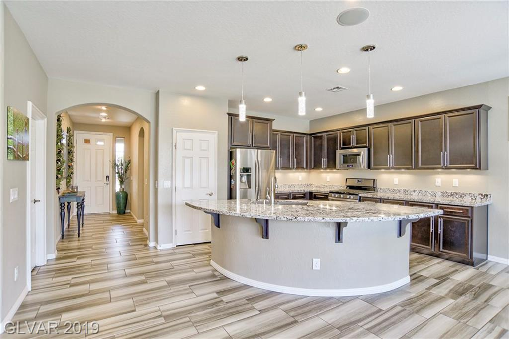 RESORT STYLE AGE RESTRICTED COMMUNITY.  BEAUTIFUL HOME W/OPEN FLOOR PLAN. KITCHEN BOASTS GRANITE COUNTER TOPS, BREAKFAST BAR, INFORMAL DINING OVERLOOKING PATIO AND SPARKLING BLUE PRIVATE POOL. A MUST SEE, DON'T LET THIS ONE PASS YOU BY!