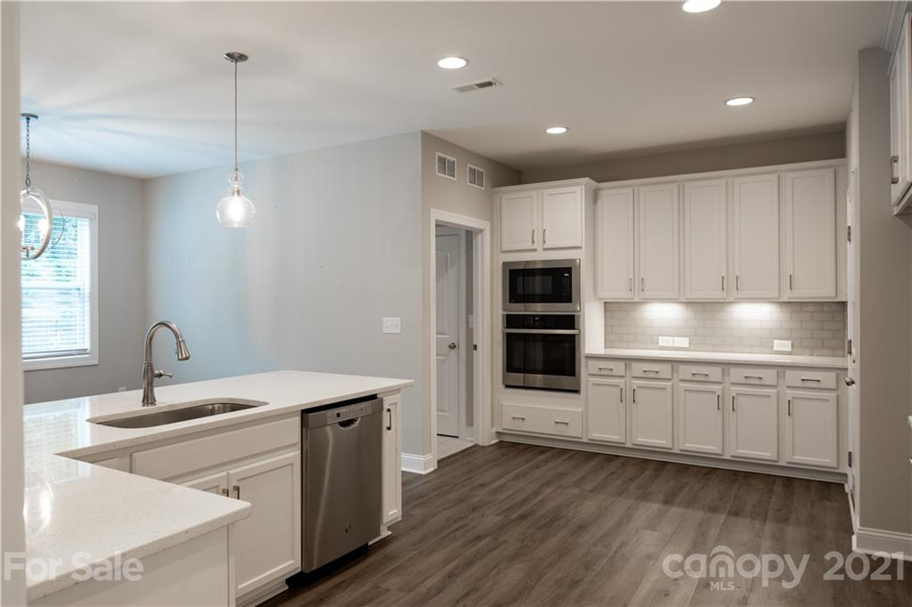 Built in 2019, this Mint Hill two-story home offers quartz countertops, and a two-car garage.