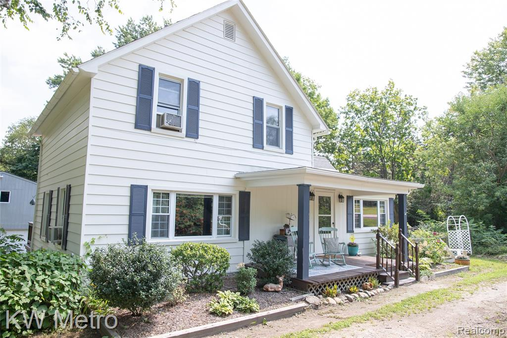 """Don't let the address fool you! After driving into the circular drive, the land rolls down into your own private and spacious yard (2 lots included in sale), surrounded by mature trees, apple and plum trees, wild berries, 2 fire pits and lots of wildlife! Large front covered porch, back deck for entertaining, FULL WALK OUT basement (partially finished), """"Garage"""" is a 24.5 x 31.5 2 story pole barn with full 2nd floor  with exterior stairs. This hard to come by farmhouse on 1 acre, is within walking distance to Downtown Romeos restaurants and shops, schools and grocery store. The interior is all updated, and boasts a first floor bedroom and bath. The 2nd floor offers some space away from the first floor Mstr Bedroom with 2 spacious bedrooms along with the 2nd full bath. Peach festival Parade starts in front of this home and can be enjoyed from drive way. YOU MUST SEE THIS BACK YARD!! NOT A :""""DRIVE-BY"""" !! **** See survey photo and aerial video!"""