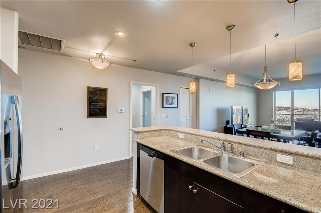 Welcome to Luxury living in a great location!  Near new RAIDERS stadium with easy access to I-15 and 215 so you can get to any side of the city with ease. Watch the fireworks from your balcony with your Iconic Las Vegas strip views.  All the amenities including guard gated, private storage unit, large pool and spa, along with 2 story gym complete with dry saunas and locker facilities.   This 2 bedroom with dual masters each with custom designed walk in closets and ceiling fans is ready for you to call home.