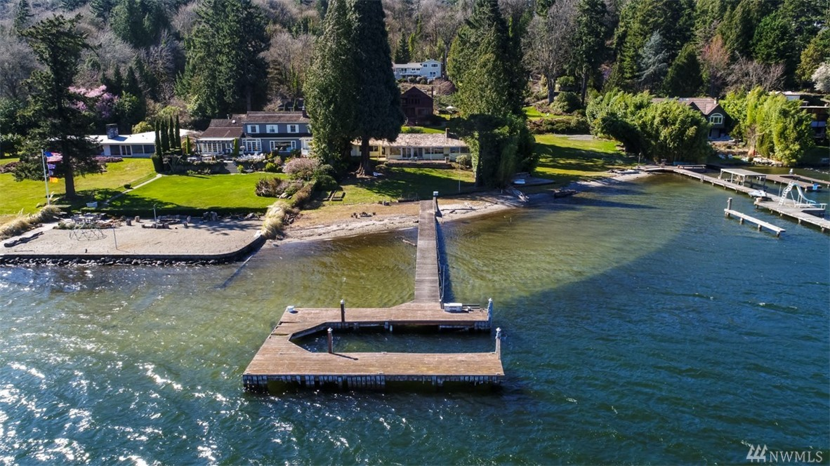 Rare Opportunity to own 89 FEET NO BANK WATERFRONT w PRIVATE DOCK for your Yacht and a few small boats or jetskis.  Locates at protrusion of Mercer Island allowing unobstructed view of the water. Private beach.  Lots of natural light into the house.  House needs to be upgraded, a flip or build your 30' Height dream home. Circular driveway. Flat lot. Imagine waking up every morning to the beautiful view of the water and sunrise. See what this almost half an acre lot can be with your imagination.