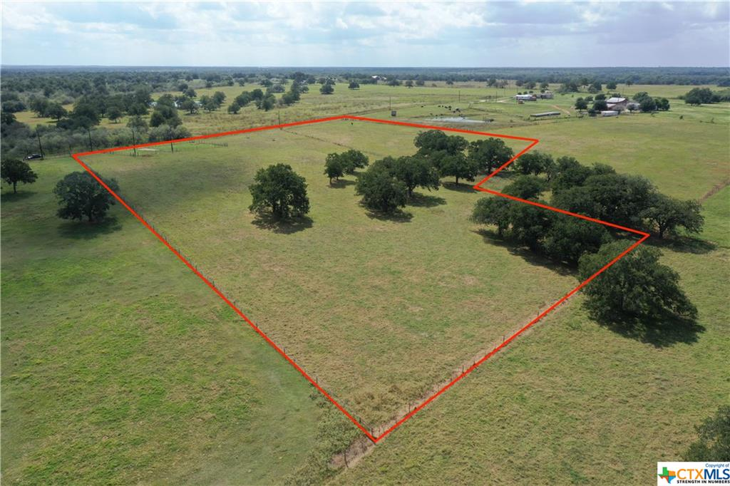 Pristine 10.01 acres, ready to make your perfect, country-side home site! Mature oak trees, cleared and maintained pasture. Property recently had an aerobic septic system installed, county water and co-op electric on-site. Not in a flood zone. Restrictions: 1 home-site only, mobile homes are allowed. No subdividing. No chickens.