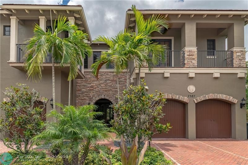 "Stunning Granada model featuring, 5 bedrooms and 4.5 bathrooms.  The expanded master bedroom is downstairs. This lovely home has a large water view, overlooking beautiful sunsets.  Marble floors, gourmet kitchen with 42"" wood cabinets, granite, stainless steel appliance, trash compactor, under cabinet lighting. A beautiful outdoor patio overlooking the water and pool with spa.  Hurricane impact windows and doors. A lovely entertainment room downstairs. Wet bar in the family room, prewired for cameras, insulated hot water system throughout the home. The master bedroom is on the main floor. Lots of storage, with a 3 car garage. The garage is large enough for a car lift.  This home has much to offer. 3.5% COMMISSION SEE BROKERS REMARKS FOR DETAILS."