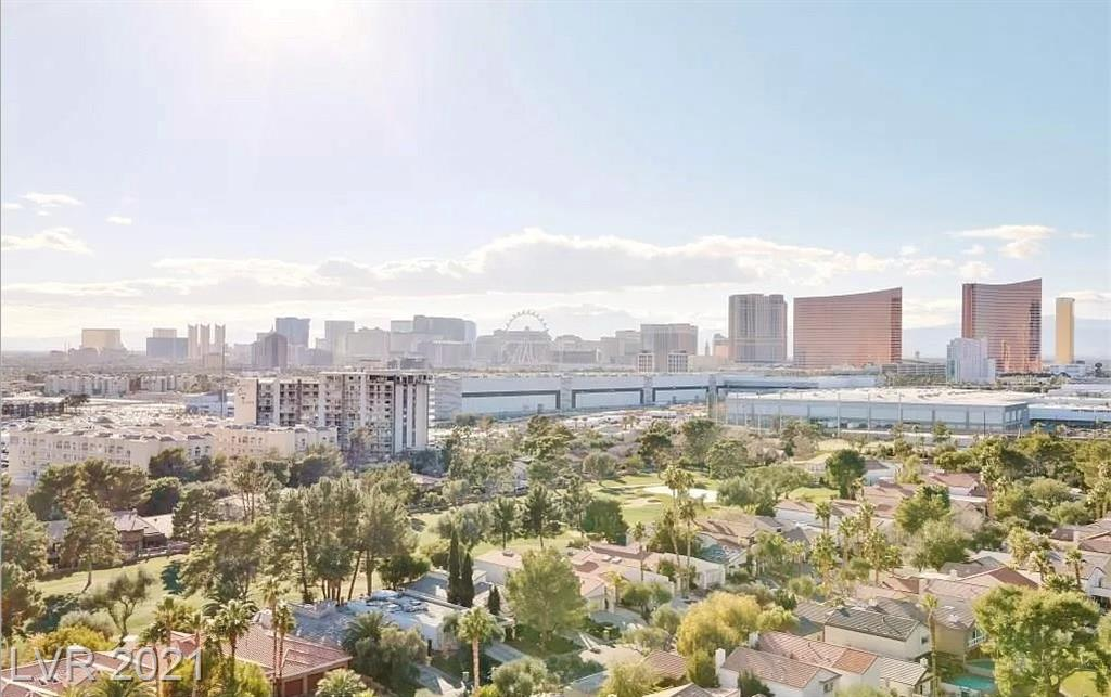 Panoramic Unobstructed Las Vegas Strip, golf course, city & mountain views in high floor corner end unit with wrap around balcony. Open layout. Rolladen rolling shutters, save on power bill. Regency Towers is the original Las Vegas high-rise living located in the Las Vegas Country Club Estates. The community is minutes from the Las Vegas Strip, Las Vegas Convention Center, UNLV and McCarran Airport. The LVCC also includes three 24 hour guard gates with roving patrols & mature landscaped streets pleasant for walking or jogging. Regency Towers amenities include: concierge, valet, 24/7 security, pool, spa, fitness center, BBQ, covered parking, storage, laundry, sauna, tennis court & dog park. This unit can convey fully furnished and negotiated as such, excluding current renter's personal items. All appliances are included in sale.
