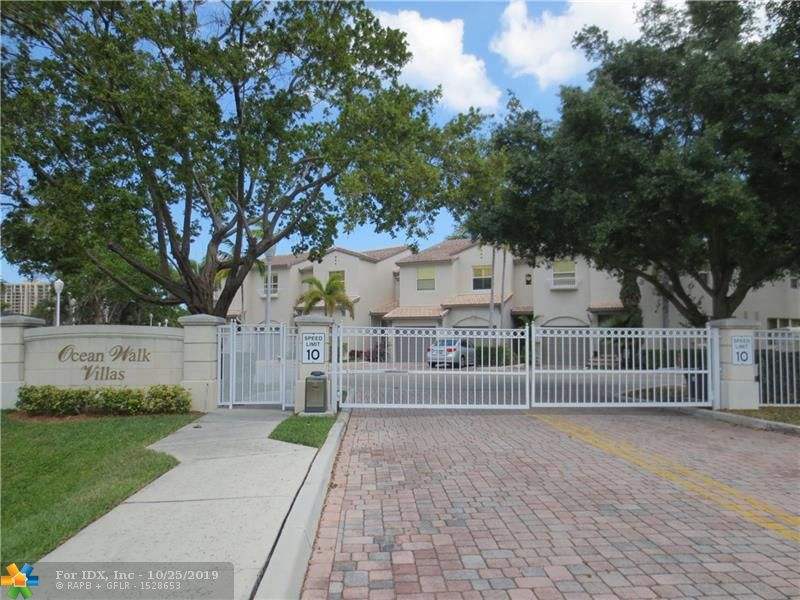 Welcome to Oceanwalk Villas.  A Gated Boutique Complex  just 4/10 of a mile to the Town beach access.   Walking Distance to the Shops and Restaurants of Charming Downtown of Lauderdale by the Sea.  Impact Windows and Doors.  Updated Stainless Appliances.  A/C Replaced 2017. Attached Garage, plus parking Space in Front of Unit.  Additional 26 Blanks surround the complex.  Monthly HOA of 469 Includes Building Wind/Hazard and Flood Insurance.  Trash pickup included in HOA.  Complex Heated Pool.  Second Floor Den area Makes a Great TV Room or computer Room.  Laundry area on Second Floor.  Vaulted ceilings and walk in closet in Master Bedroom.  Master Bath Suite offers a separate shower, soaking tub and dual sinks. Pet Friendly Complex allows two pets any size.