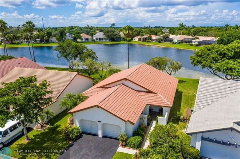 FABULOUS LAKEFRONT LOCATION IN COUNTRY ISLES II. NEWER ROOF, NEW A/C APRIL 2016, NEW HOT WATER HEATER 2019.  NEW ACCORDION SHUTTERS AND IMPACT GLASS.  3 BEDROOM/2BATH SPLIT FLOOR PLAN, HUGE COVERED SCREENED PATIO OVERLOOKING THE LAKE.  NEUTRAL LAMINATE FLOORING THROUGHOUT WITH HIGH BASEBOARDS . LOW HOA FEE INCLUDES LAWNCARE AND LANDSCAPING.  WALKING DISTANCE TO COUNTRY ISLES ELEMENTARY, TOWN CENTER AND PUBLIX.  MINUTES TO I-75. HURRY TO THIS ONE. WONT LAST!!