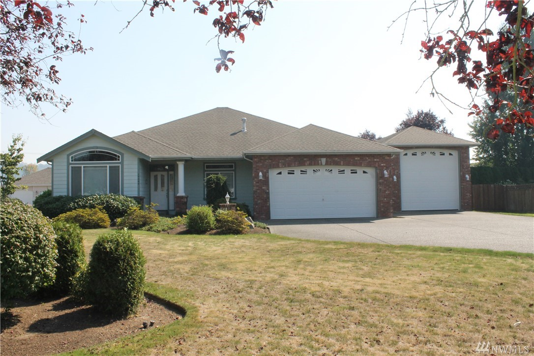 Beautiful 3 bedroom one story custom home on this large .36 acre lot. Quality Spyglass division across from golf course with Mt Rainier view. Two car attached garage AND a 640 square foot garage for your RV. 20x40 3rd bedroom used as an office.
