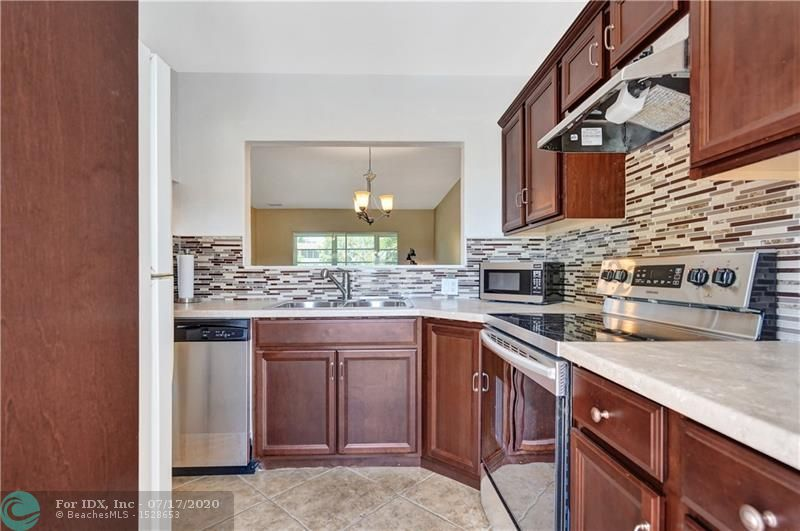 Enjoy the charm of this clean and quiet 55+ community. Completely remodeled and ready for you to move right in! This condo is very bright from beaming natural light and you will notice no expenses have been spared on updates. Gorgeous Kitchen with new counter tops & a glass-tiled back splash. Tile floor in the living area and beautiful dark espresso wood floors in the bedrooms. Both bathrooms are updated, one with a stand up shower and one with a tub. Impact windows and doors. Sit on your balcony, open the windows for some fresh air and enjoy the tranquil views of the courtyard and pool area. Comes with a storage unit. Community has newly Renovated Gym/Fitness Room. Unit is located very close to the laundry room. The perfect escape to be your vacation home or primary residence.