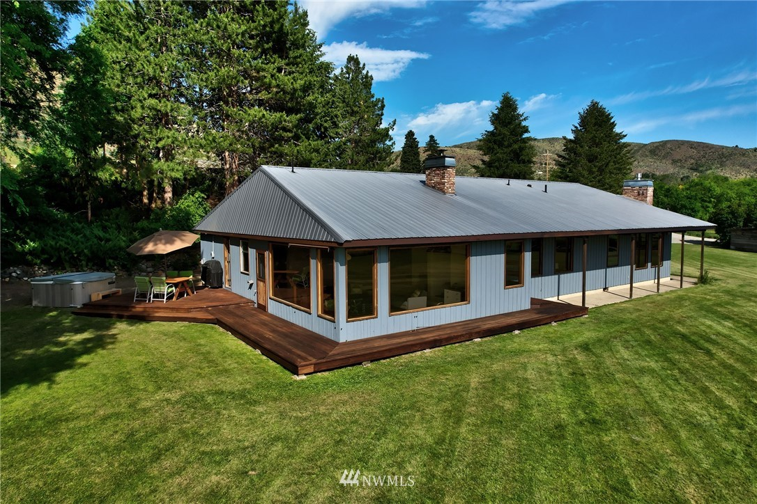 Just one mile from downtown Winthrop on the backside road to Twisp. Truly one of the best unobstructed views in the Methow Valley-a protected 180' view from the Sawtooth Mountain Range to Mt Gardner and up the valley to the North Cascades. This stylish ranch rambler has been completely customized w/a mid-century modern aesthetic by a local designer. Open floor design is perfect for entertaining with two living areas, dining room & large kitchen with bay window breakfast nook. Inviting back deck shaded on hot summer afternoons. Coveted irrigation shares for just over five acres provides firewise safety & maintains its agricultural appeal. Create your perfect healthy work-life balance in this peaceful country home with a million dollar view.