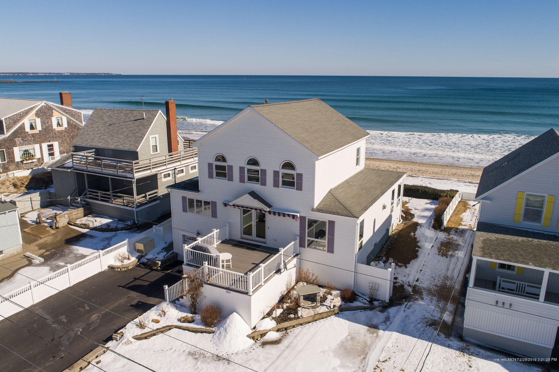 Still looking for an oceanfront property? How about one with 55'of deeded waterfront? With no rocks taking up valuable 'beachestate' to climb over, no bluff to climb down from, no seawall to navigate, just 2 steps down to a soft sandy beach, even at high tide! Located near the north end of Atlantic Ave on Wells Beach  this beautiful home built in 1896, purchased in 1942. 4 1/2 generations later   completely renovated, remodeled and updated inside and out. Turn-key and maintenance free. On the back is a large weatherproof deck, with a full roll out awning and a tankless gas grill providing a space for nonstop grilling and outdoor entertaining. Inside is a full open common room with new oversize windows everywhere to provide an everchanging, overwhelming 180 degree ocean view.    ss, granite and island with cooking space and a 4 top breakfast bar.comfortable diningarea.Upstairs2bdrms,1bth plus Ensuite MB w/panoramic ocean,view incl.moon and sunrises.Stop looking. This is a must see.