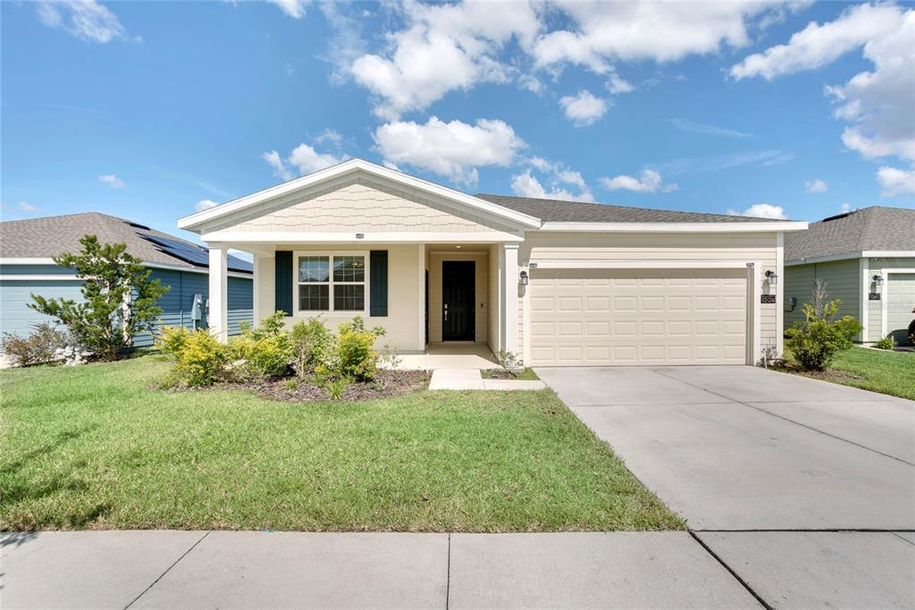 """One or more photo(s) has been virtually staged. There is no need to wait 7 to 10 months to build a new home!! This is a 2020 built home, NEXT GEN Lennar model, 4 bedroom, 3 baths, plus office/den, 2 car garage home. The next-gen suite has its own entrance unit has its own kitchenette, living space, bedroom, and private bathroom fully loaded with washer and dryer and refrigerator giving privacy in proximity. This home sits on a premium lot with lake views and conservation views. Home has a dock permit should you want to build a dock. This home comes fully equipped with Everything Included Features like stainless steel appliances, quartz countertops throughout, and oversized tile flooring in the wet areas. This Ecosmart home has solar power to offset the electric bills and comes fully connected with features like a Honeywell thermostat, Schlage lock, Ring doorbell, and pest guard control system. Don't Miss out on this Innovative home found close to the Heart of Haines City! The Estates of Lake Hammock is a gorgeous waterfront community complete with a community dock, walking trail, and dog park. There is easy access to I-4, Walt Disney World, Universal Studios, Legoland, Bok Tower Gardens, Posner Park Shopping Mall, Hospitals, and much more, it's easy to see why this area is growing fast! For families seeking new homes situated in a rural setting while still close to Tampa and Orlando, the """"Estates at Lake (Double door refrigerator does not convey)"""