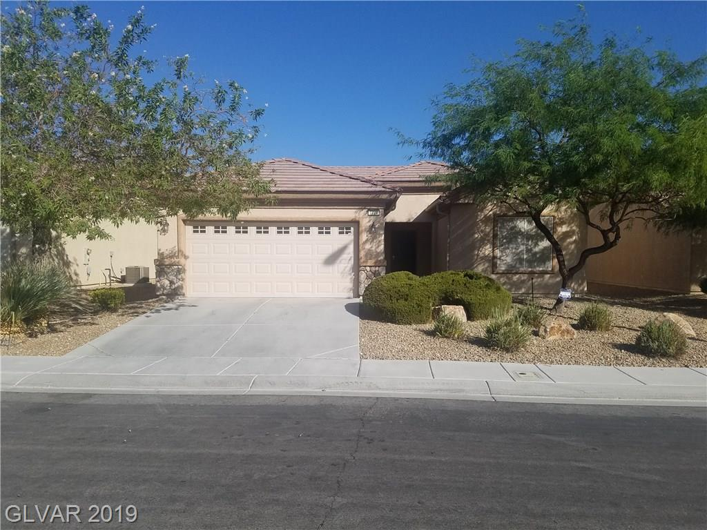 Golf course frontage. Beautiful 3 bedroom Sun City Aliante home that overlooks the golf course. Fresh paint and new carpeting throughout the home.