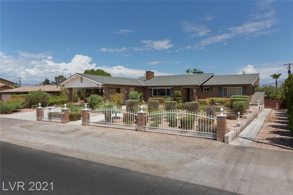 TOTAL SQUARE FOOTAGE IS 2,734 sq ft!  This BRICK home is being presented to the market for the FIRST TIME.  Original family ownership.  The full, finished basement boasts 1 bedroom, 1 bathroom and 3 flex rooms! It could easily be utilized as a five bedroom home.  The first floor offers two bedrooms and two baths.   Almost 1/2 acre of Vintage Vegas.  There is room for horses, RV, garden....use your imagination!  Beautiful woodworking throughout home.  Two car garage PLUS a two-car porte cochere.  Private backyard oasis with a large, deep pool and mature landscaping.  Roof was redone 15 years ago, skylights and new windows installed in the '90s.  A beautiful property with amazing acreage in the heart of Las Vegas.