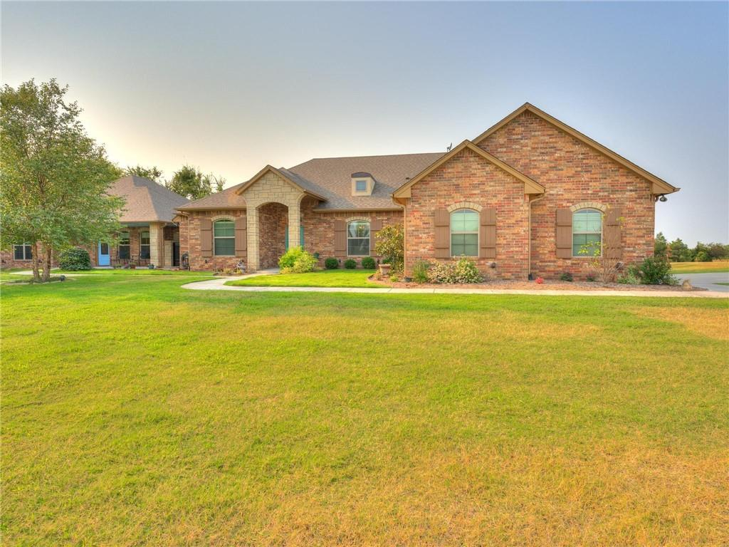 This 5 acre Deer Creek property is one of a kind featuring a full guest house with safe room, detached garage/workshop, brand new back patio pergola and no restrictions on the land! The design of the property boasts thick granite, hardwood flooring, accent beams, stone fireplace, huge master closet with built-ins and more! The guest house is perfect for multi-generational families, older kids or an upgraded man cave!! It has a full kitchen, living, bathroom, washer/dryer hookup and 2 bedrooms with it's own private access. The detached 30x40 garage has a full epoxy floor, half bath, separate workshop with AC and heating as well as a storage lift. The acreage is partially fenced and has a secure entry with a solar powered privacy gate. Located right across from Deer Creek Middle School, this won't last long!
