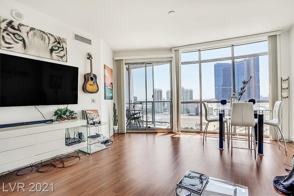 Very nicely upgraded 2 bedroom + 2 bathroom unit located on the 22nd floor of Allure condominiums with sweeping Strip views. Unit features impressive floor to ceiling windows throughout, wood flooring, expansive primary suite + walk-in closet.  Enjoy 180 degree city views from the terrace located off of the living room.  Unit is tenant occupied through 11/30/21.  Opportunity to be sold as an income property or to move in immediately after lease end.  Building amenities include 24 hour security, pool, spa, fitness center, concierge & valet.  Free satellite TV.