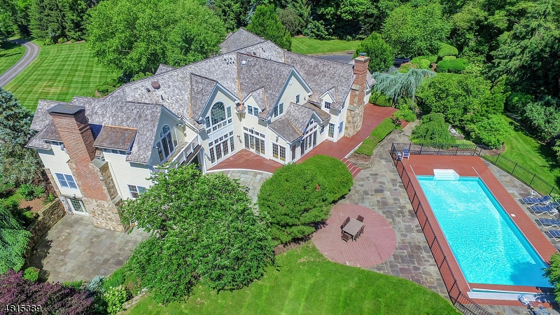 Truly spectacular & sundrenched home w/ a blend of sophistication & style!  A priv lane just min to twn leads you to this beauty  set on 5 ac of expansive lawn, specimen plantings & garden paths. Upon entry,note the walls of windows/doors w/ access rear patios & offering views from every rm.. Hardwd flrs & custom millwork is feat.thruout. The newer poggenpohl kit is the chef's delight & entertainer's dream w/dbl top of  line stoves,ovens,dishwashers,fridges; the works!, this heart of the home is open to the fam rm w/ cathedral ceil/expansive beams, & impressive back staircase. Guest bdrm/bath on 1st flr w/ priv patio.2nd flr feat 2 wings of bdrms & 1 of 2 laundry rooms.Fin.walkout bsmt w/ office & full bth.Whole house gen.,multi zn HVAC & wood roof new w/in last few yrs.POOL & TENNIS. TAX APPEAL UNDERWAY!
