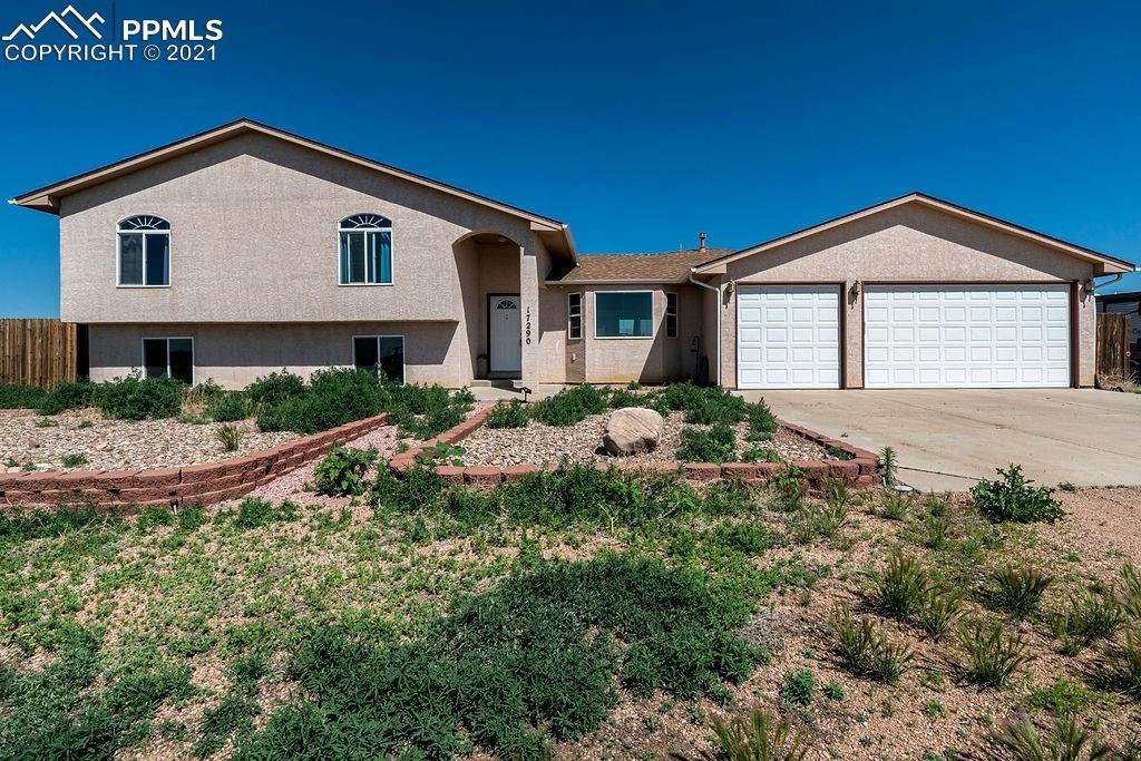 """This is a very special rural property with 360 degree views of Pikes Peak and the surrounding areas of south El Paso County, within minutes of stores, restaurants, and city amenities!  Enjoy a large living room/kitchen area with upgraded walnut cabinets, a 5-burner gas range, lots of kitchen storage, and vaulted ceilings with a large bay window on the main level.  Ceiling fans throughout the home complement the central air/heating system.  Take advantage of the Rinnai """"on-demand"""" hot water heater, central vacuum system, and two water softener units.   The master bedroom has """"his and hers"""" closets with a 5-piece bathroom.  On the lower level, relax in a comfortable family room with a fireplace, with two adjoining bedrooms and a full bathroom.   The backyard is fully fenced and includes a storage shed and a sheltered 45'x19' area for your outdoor equipment and """"toys.""""  Owner currently uses satellite Internet access and is able to utilize high-speed service.   There is an additional refrigerator and freezer, along with a fully-functional security system with DSC alarm panel, digital recording, seven cameras and a LCD monitor, which will be included in the sale.  Also, there is a phone """"app"""" which controls the thermostat for heating and cooling. PLEASE NOTE THIS ADDITIONAL OPPORTUNITY! Purchase of this property also includes an adjacent 15-acre vacant lot with the address of: 17230 Dude Ranch Point, Fountain, CO. 80817.  The legal description of this additional lot is: Tract A, Pioneer Village Filing No. 2, Plat No. 3351, County of El Paso, State of Colorado.  The tax number is: 57080-04-006.  If you enjoy rural living and plenty of area to ride motorcycles and ATVs, having both lots at your disposal is a great opportunity!"""