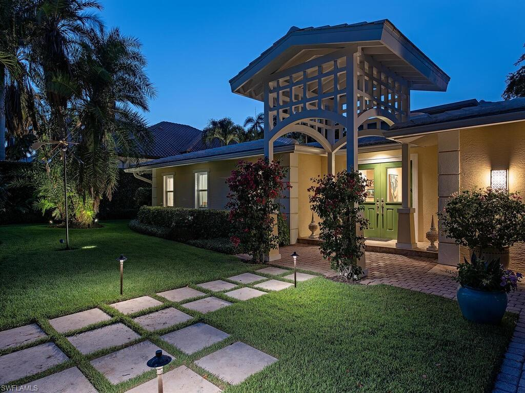 H2269 - Enveloped by tall hedges and nestled on Naples' most prestigious street lies an impeccably maintained residence that affords nearly every Buyer's desires.  Over 3,100 square feet of thoughtfully designed living space has gone under extensive renovations within the last ten years and offers 3 bedrooms, each with an en-suite bathroom, a loft that creates the ideal office space, as well as a generously sized kitchen which seamlessly opens to the light and bright family room boasting 15' soaring ceilings.  Beyond the main living space's French-doors, dream-like entertaining can be had surrounding the pool, or a quiet lunch can be enjoyed in the side yard hosting a variety of fruit trees and a stone pond.  Merely one block from sugary white sand beaches and a short stroll to all of Downtown Naples has to offer, this makes for the ideal Naples retreat!