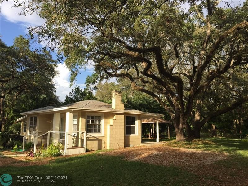 Rare find Old Florida!Charming solid CBS construction home with a oversized 10,979 sq ft lot w beautiful oak trees and lots of yard space to entertain your friends and family in this gorgeous and amazing yard, nothing else like this on the market! Lots of possibilities also with RD15 zoning. New flat roof and bath, recently upgraded water heater, electric panel, central a/c. Beautiful hardwood floors and all new paint. Gazebo and separate building can use as an entertaining bar or use as storage.The possibilities are endless with this incredible house that backs up to the park. (Please don't disturb tenants) lease expires May 2021, call owner agent to make appointment to see this lovely home. Home and yard has been all dry with all the recent rain. Home built up off ground with crawlspace.