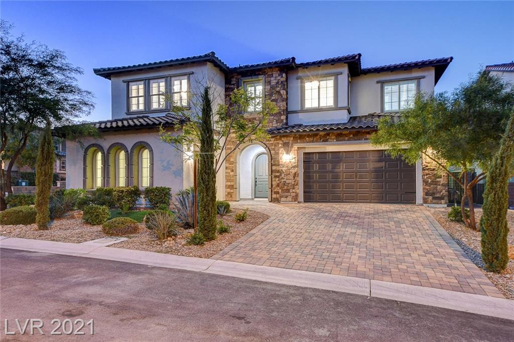 Remodeled gated gem in coveted Summerlin. This 2016 Toll Brothers home features 6 baths & 5 bedrooms whereas 4 are en-suite with walk-in closets. An oversized kitchen island with seating for 6, a wet bar w/ ample built-in wine storage, and a modern linear fireplace, makes this home ideally suited for fun gatherings with family & friends. Brand new soft close cabinets, quartz countertops, stunning light fixtures, and waterproof luxury vinyl floor planks throughout. Resort-like primary retreat w/ state of the art closet and spa inspired bathroom. Brand new pool with a zero-edge spa (in-floor cleaning system, LED lights & operated w/ Pentair app), BBQ island and gorgeous landscaping. Perfect location, close to Downtown Summerlin Mall, great schools, and Red Rock Conservatory. No expense was spared and every detail was beautifully thought out. If you are looking for a home that feels brand new, inside & out, this is the home for you. Schedule a tour to view this stunning luxury home today!