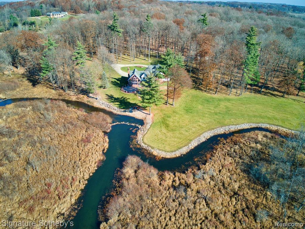 Fabulous Fishing and Hunting Paradise on 30 Pristine Acres. Wonderful Family Home with Lots of Room for the Children to Play and Investigate. Beautiful 4,485 sq ft. Spacious Tudor with Views from Every Room. Overlooking the South Branch of the Flint River and Whigville Creek. Trout, Deer, Turkey, Grouse and Pheasant all share this Property. Totally Secluded with All High End Amenities. Very Traditional with Huge Family Room with Large Stone Fireplace Overlooking the Beautiful Parklike Setting. Stunning Hardwood Forest Surrounds the Home. 3BR/ 4.5BA/ 3.5 Car Gar + 30 X 40 Pole Barn to Store your Toys. Geo-Thermal Heating & Cooling/ Natural Gas to Home/ Whole House Generator/ Too much to list. Your Own Private National Park. 24 Hours to Show.