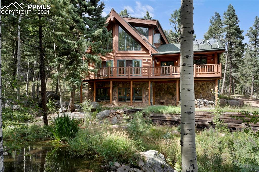 This is an Extraordinary Log Home, nestled in Aspens, with its own pond and babbling waterfall in beautiful Crystal Park. Stunning architecture and mountain character throughout. Gracious Mountain living, blending native materials with modern design elements. Large deck with wonderful treetop views and views of the stream and pond on property. This 3 Bedroom, 4 Bathroom residence includes Gourmet Kitchen with Live Edge Granite Counter Tops, Custom Built-In Counter Seating, Custom Tile and Hardwood Flooring with Radiant Heat. Other Features include: Solar Panels, Heated Garage, Newer Furnace, Newer Water Heater, Newer Boiler, Fixed Gas Fireplace, All Bathroom Fixtures oil Rubbed Bronze, Heated Toilet Seats in 3 out of 4 bathrooms, Newer nest System Throughout, Wood Stove in Family Room and much more! This Log Home is the Perfect Mountain Retreat for your family and friends. Enjoy the changing seasons. Mature aspens, pines and wildlife views from every room. Rare Stream and Pond on this private location. Living room features Hardwood Flooring, Pella custom High-Efficiency Windows, Lodi Wood Burning Stove and Cathedral ceilings with wall of windows soaring 2-stories. Gather around the fireplace in the Family room directly off the well-appointed Gourmet kitchen. Attention to detail throughout. Main level also includes Master Bedroom, adjoining 5-piece Bath with Jetted Tub and Large Walk-In Shower…Also on the main is a 1/2  Bath and Laundry. Loft Bedroom includes 4-piece Bath and Separate Sitting Area which creates the peaceful feeling of living in the tree tops. 1,700 sq ft of downstairs living with the 3rd Bedroom, 3/4  Bath, Exercise Area and Walkout to Garden Level and Pond. Watch the birds, deer, turkeys, foxes and more. This true Log home in an absolutely spectacular setting, is worthy of it all! Crystal Park is a private, four-season destination situated on 2,000 acres. Amenities include fishing, Swimming Pool, Guard Gate, clubhouse, miles of Trails, & much more.