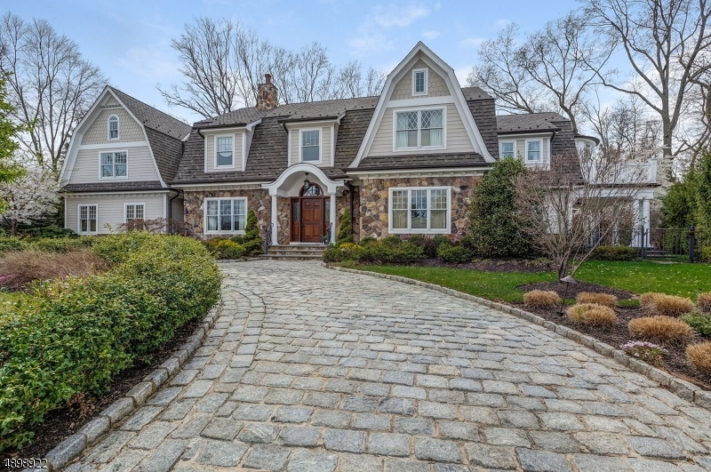 Built in 2010 this one of a kind custom home is nestled on over half an acre of beautifully landscaped property that backs up to baltusrol golf course. Custom features include a large belgium block driveway, hardy plank and real stone siding, oversized three car garage, 3 story elevator, mahogany wood paneled great room and more custom features. Close to NY transportation, houses of worship, school systems + more.